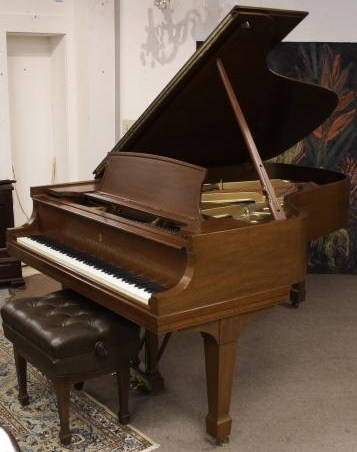 Steinway Mahogany Model B Grand Piano And Bench. Sold For $15,600