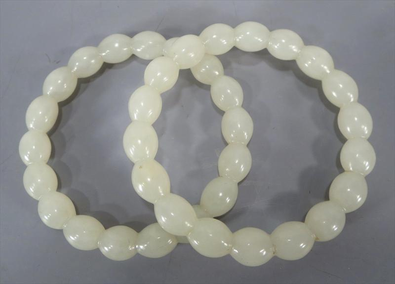 Pair Of White Jade Bangle Bracelets, 20th C. SOLD FOR $12,013.