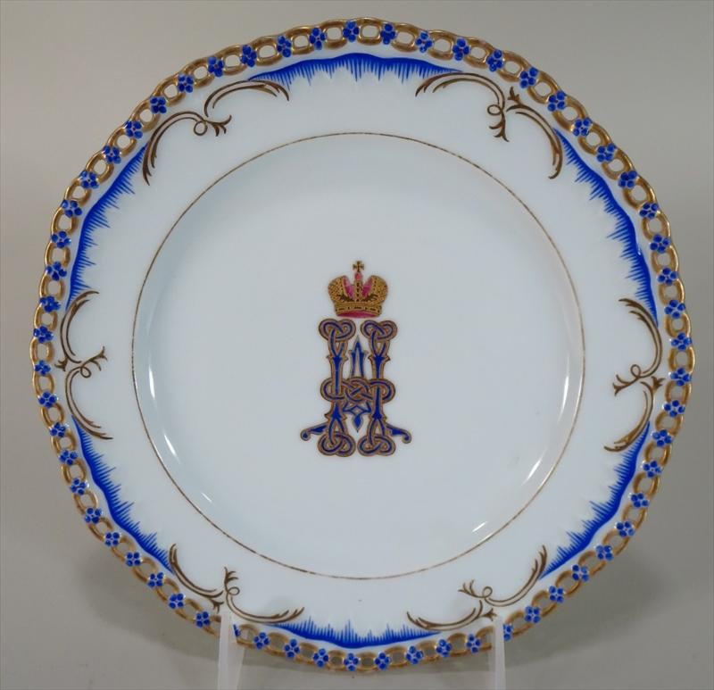 Set Of 14 Monogrammed & Armorial Decorated Porcelain Plates. Sold For $22,500 On October 15.