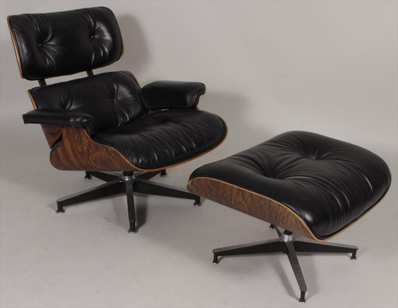 Charles And Ray Eames For Herman Miller, Black Leather Lounge Chair & Ottoman. Sold For $3,656