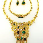 Patek Philippe Yellow Gold, Chrysicola And Asurite Necklace, Earrings And Watch Bracelet. Sold For A Combined Price Of $38,187