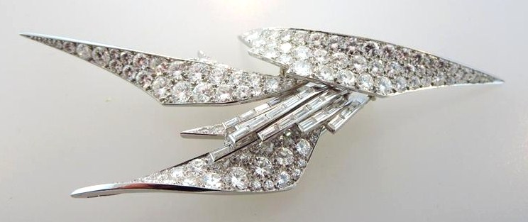 Sterle Platinum Round And Baguette Diamond Pin. Sold For $36,250