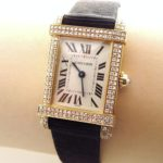 Cartier Gold & Diamond Wrist Watch. Offered In LCA's Thankgiving Holiday Auction.