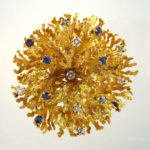 Gold, Sapphire & Diamond Floral Spray Brooch. Offered In LCA's Thankgiving Holiday Auction.