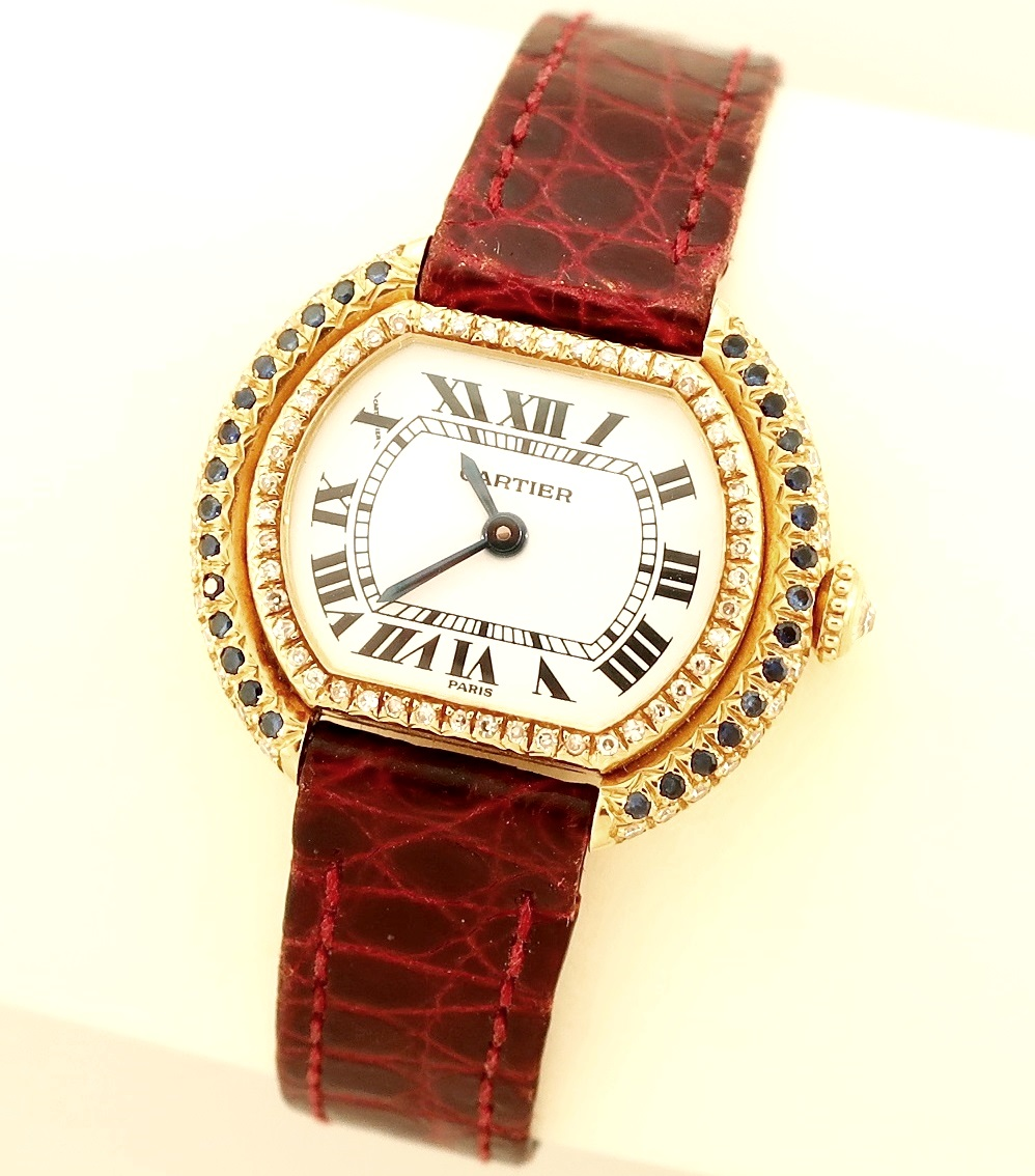 18K Gold Cartier Paris Diamond & Sapphire Ladies Watch. Sold For $3,750