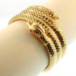 18K Gold Serpent Stretch Bracelet. Sold For $3,000