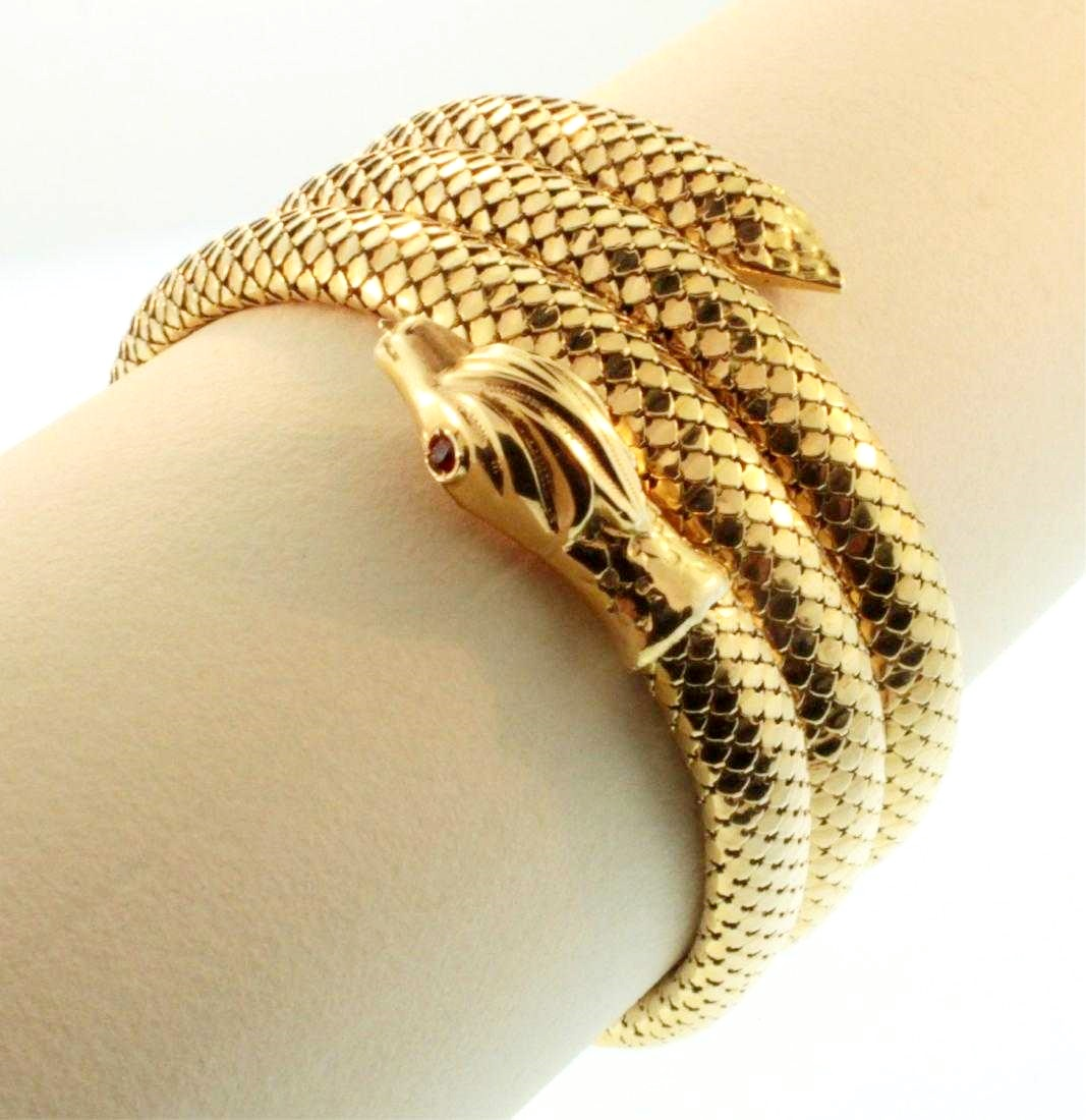18K Gold Serpent Stretch Bracelet. Sold For $3,000