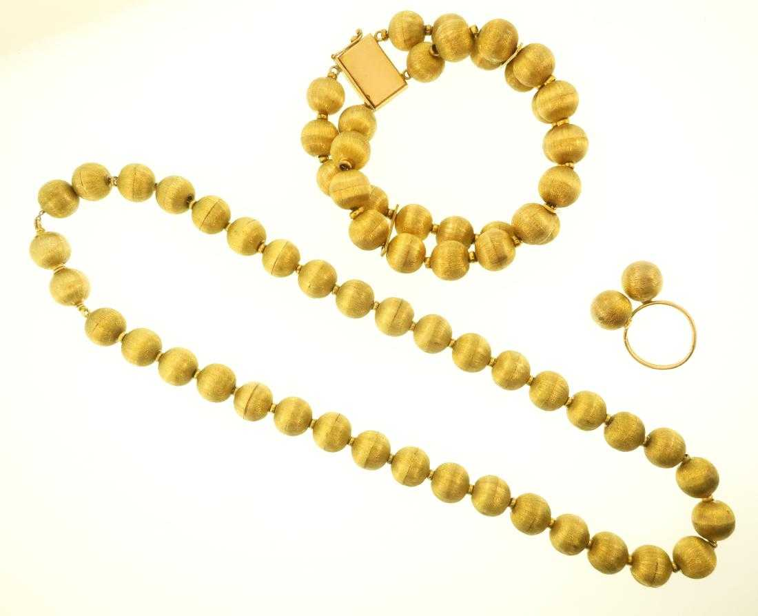 18k Satin Gold Beaded Suite. Sold For $2,750