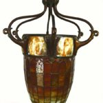A Rare Tiffany Studios Turtleback Tile, Leaded Glass & Bronze Acorn Form Hanging Lantern. Sold For $117,000.
