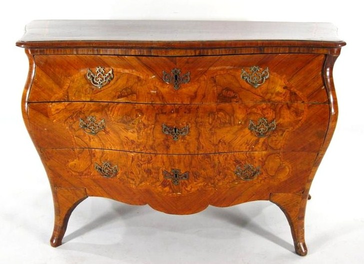 A Rococo Bombe Inlaid Burl Fruitwood Commode, Italian, 18th C. Sold For $21,600.