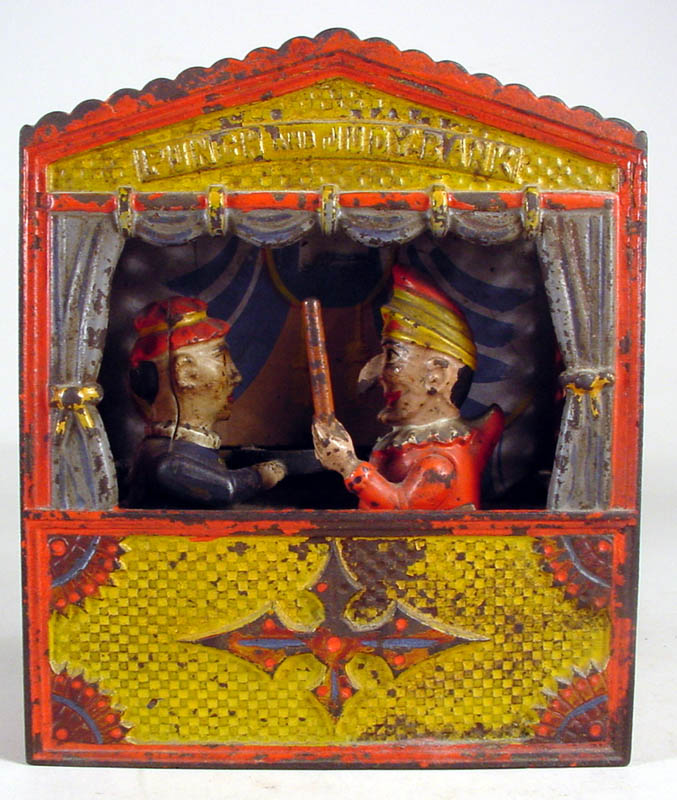 American Cast Iron Painted Mechanical Punch And Judy Bank, Late 19th C.. Sold For $875.