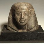 Ancient Egyptian Granite Head Of A Noble Or Official, Dynasty XII, C. 1800 BC. Sold $8,125.