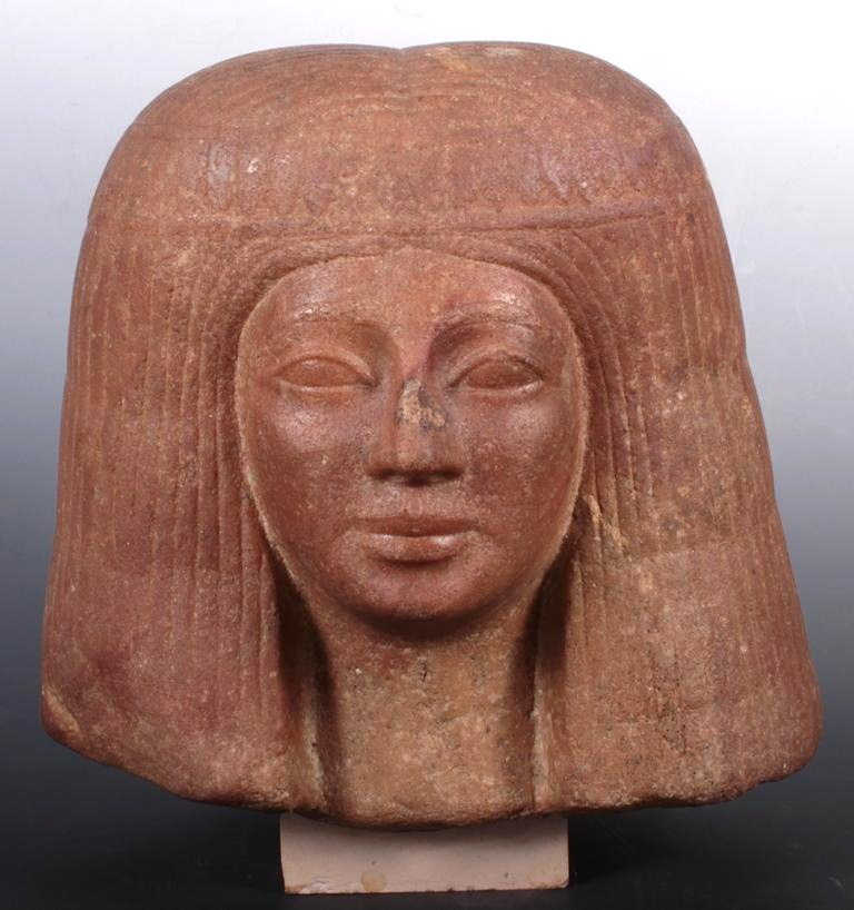 Ancient Egyptian Quartzite Head Of A Woman, C. 1500-1200 BC. Sold For $15,600.