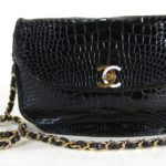 Black Alligator Chain Handle Shoulder Bag By Chanel. Sold For $2,625.