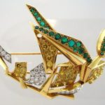 Cartier Gold & Platinum White & Yellow Round Diamond & Emerald Figural Brooch. Sold For $22,500.