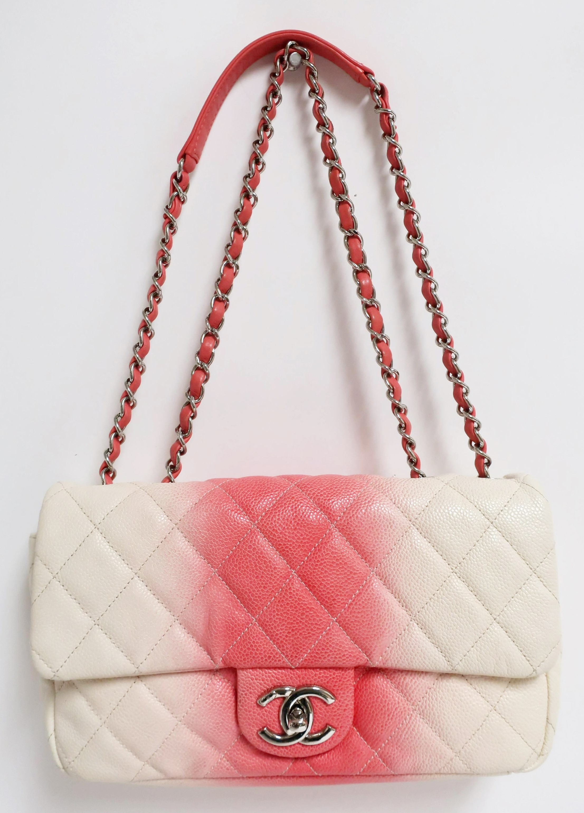 Chanel Bicolor East West Flap Handbag. Sold For $1,950