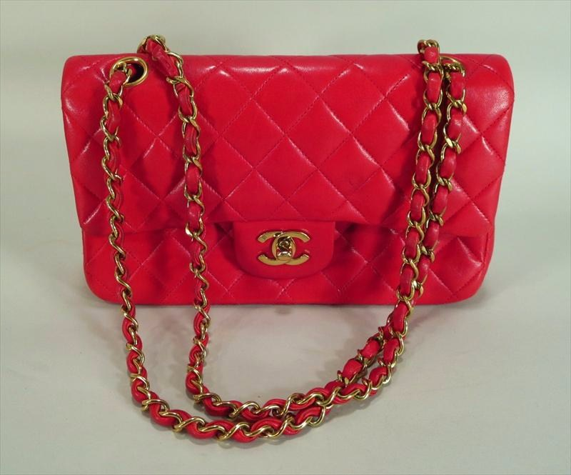 Chanel Classic Red Lambskin Bag Series 2.55. Sold For $1,750.