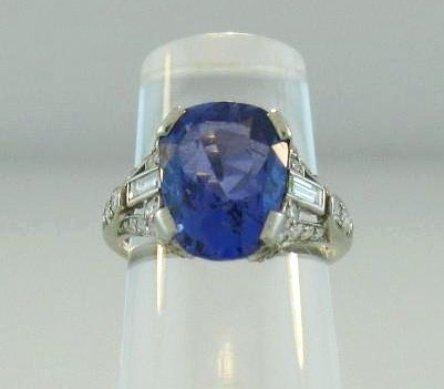 Cushion Sapphire, Round & Baguette Diamond Platinum Ring. Sold For $6,562.