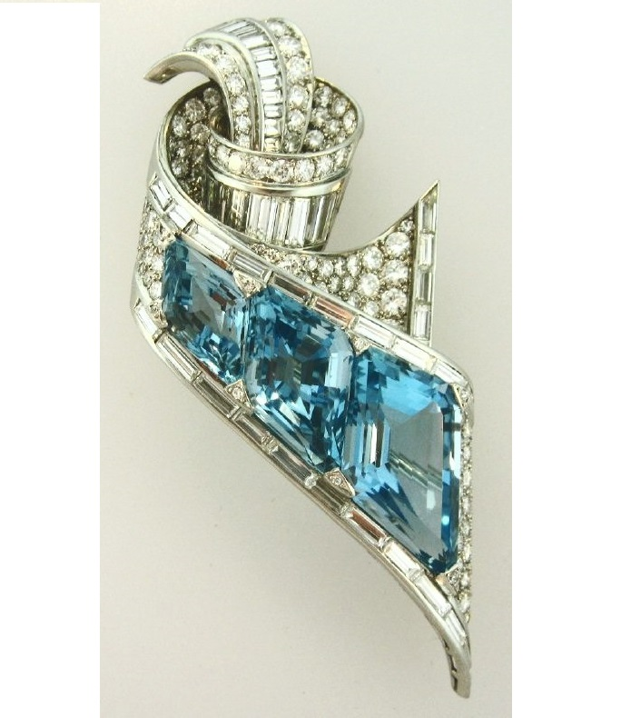 Fancy Emerald Cut Aquamarine, Round & Baguette Diamond Platinum Brooch. Sold For $15,000.