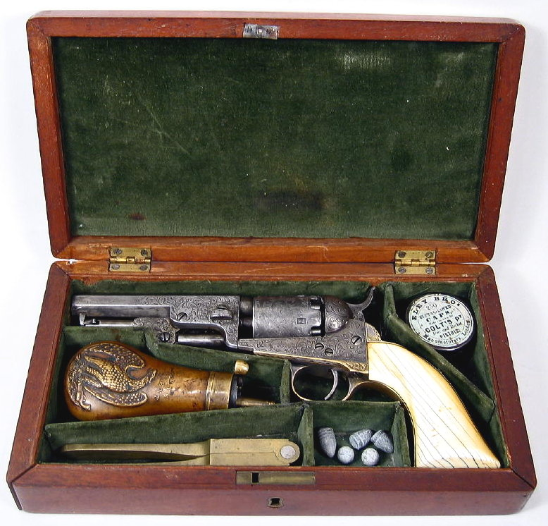 Fine Cased Factory Engraved Gustave Young Colt Pocket Revolver, 19th C., Model 1849. Sold For 9,000.