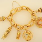 Lot 314. 18K Gold Charm Bracelet With Charms. Sold For $3,000