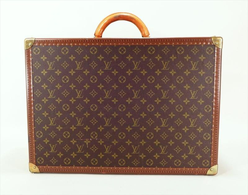 Louis Vuitton Logo'd Hard Side Suitcase, Made In Paris. Sold For $1,073.
