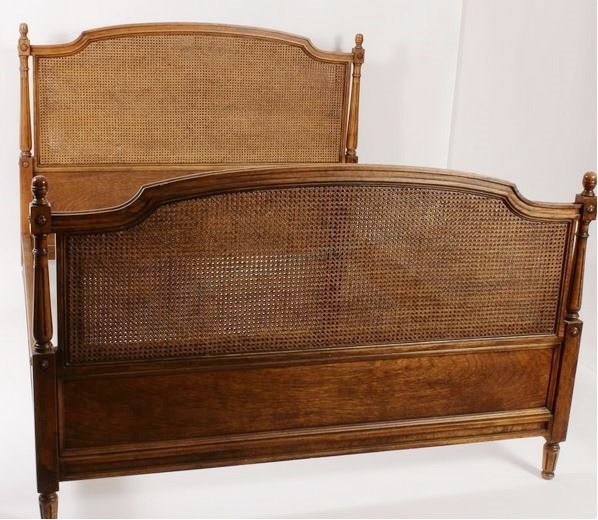 Louis XVI Style Wood And Cane Queen Bed. Sold For $11,250