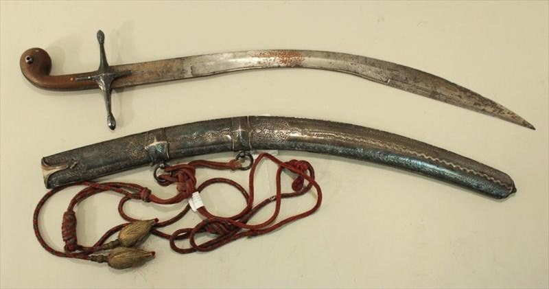 Middle Eastern Curved Steel Sword. Sold For $9,687.