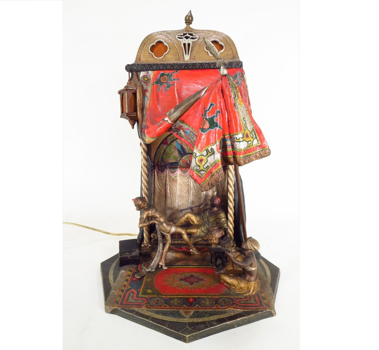 Orientalist Cold-Painted Bronze Table Lamp, Viennese, Late 19th C., Man Smoking In Tent Being Entertained. Sold For $9,131.