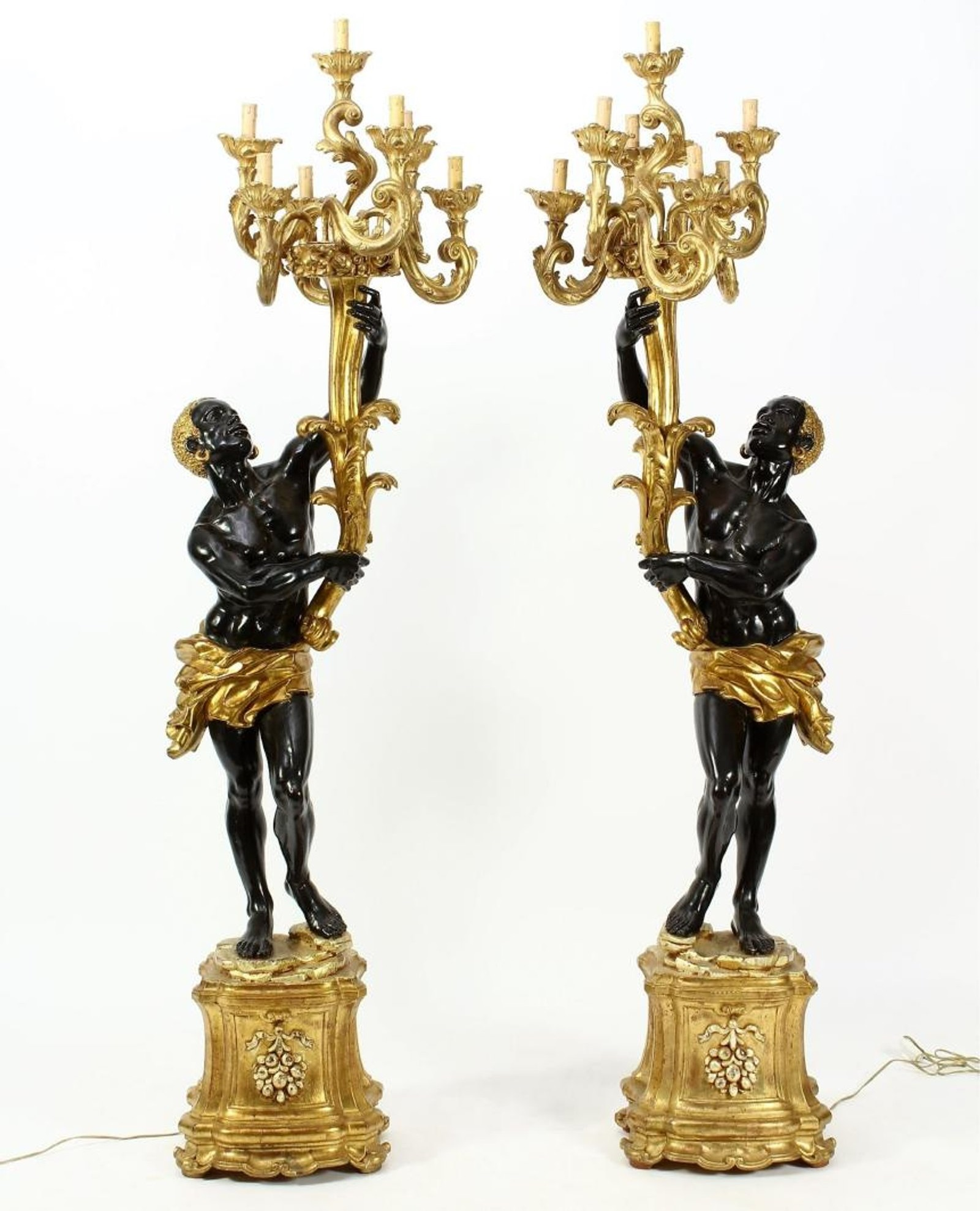 Pair Floorstanding Venetian Blackamoor Candelabra. Sold For $3,675