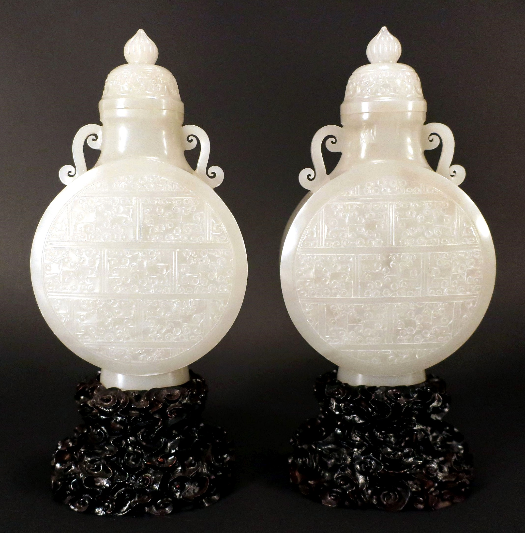Pair Of Chinese White Jade Vases With Covers. Sold For $14,375
