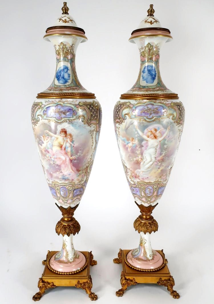 Pair Of Large Hand-Painted Porcelain Ormulou Mounted Urns. Sold For $4,750