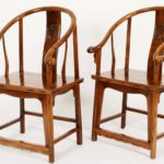 Pair Of Ming Style Horseshoe Back Arm Chairs. Sold For $18,750