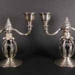 Pair Of Sterling Silver Two-Light Candlesticks By Georg Jensen. Sold For $13,750.