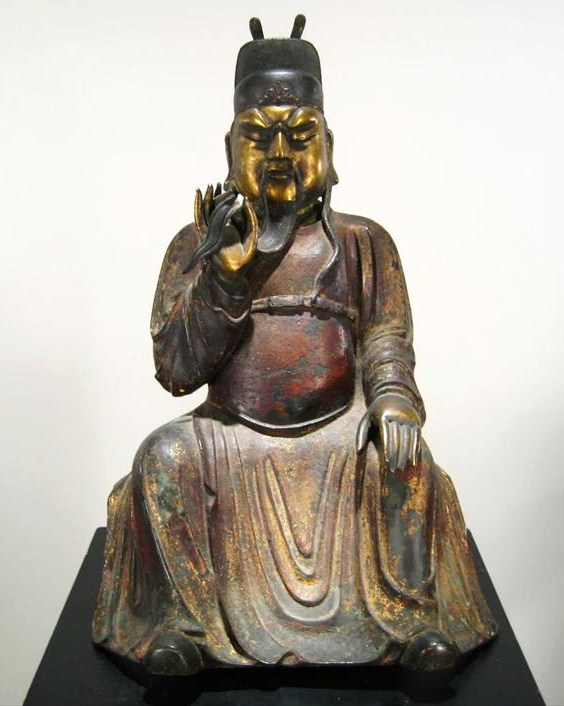 Parcel Gilt & Polychromed Iron Seated Figure Of An Immortal, Chinese, 17th-18th C. Sold For $46,200.