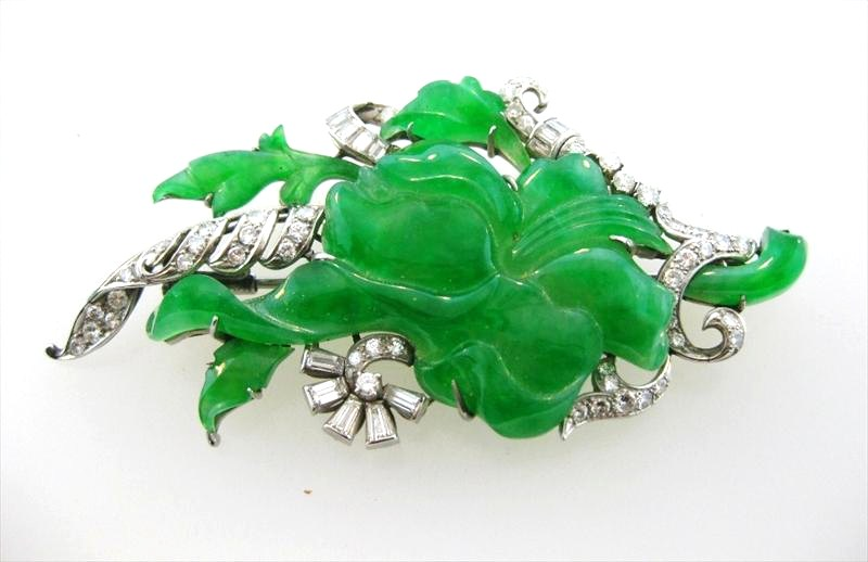 Platinum And Diamond Brooch With Floral Carved Jadeite. Sold For $6,125.