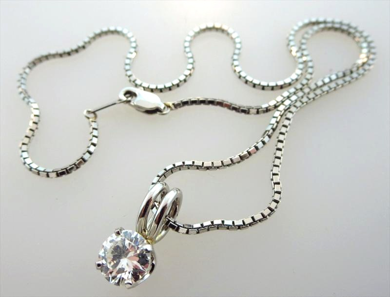 Platinum And Diamond Necklace, Sold For $10,312.