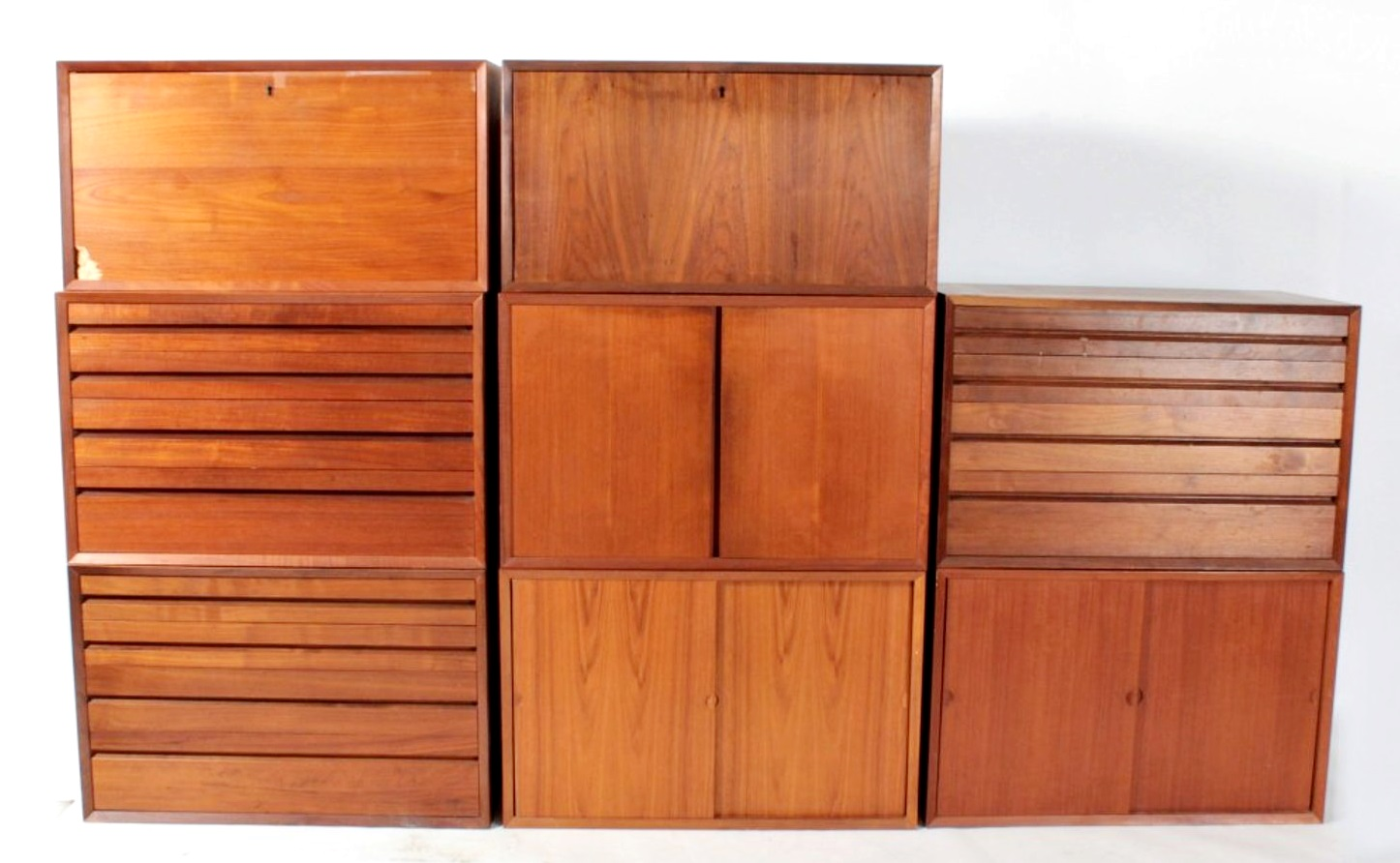 Poul Cadovious CADO Mid-Century Modern Wall Unit. Sold For $4,500