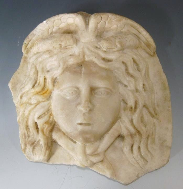 Roman Marble Antefix In The Form Of The Winged Head Of Medusa , C. 1st – 2nd C. AD. Sold For $3,013.