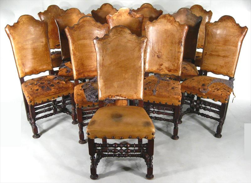 Set Of 12 Walnut Highback Leather Dining Chairs, Early 20th C. In The 17th C. Style. Sold For $20,400.