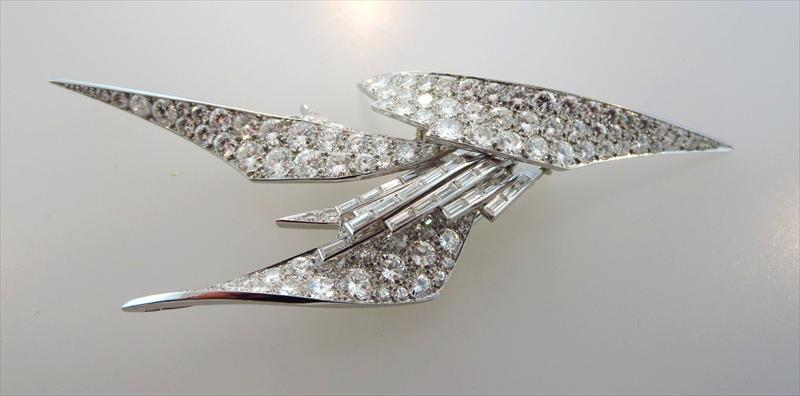 Sterle Platinum Round And Baguette Diamond Pin. Sold For $36,250.