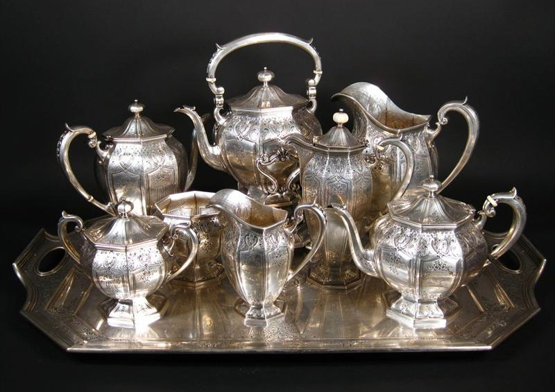 Sterling Silver 9-Piece Tea Set, J. E. Caldwell, Philadelphia. Sold For $7,937.