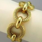 Tiffany And Co. 18K Gold Round Link Bracelet. Sold For $5,375.