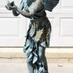Victorian Cast Iron Angel Holding Songbird, 19th C. Sold For $4,000