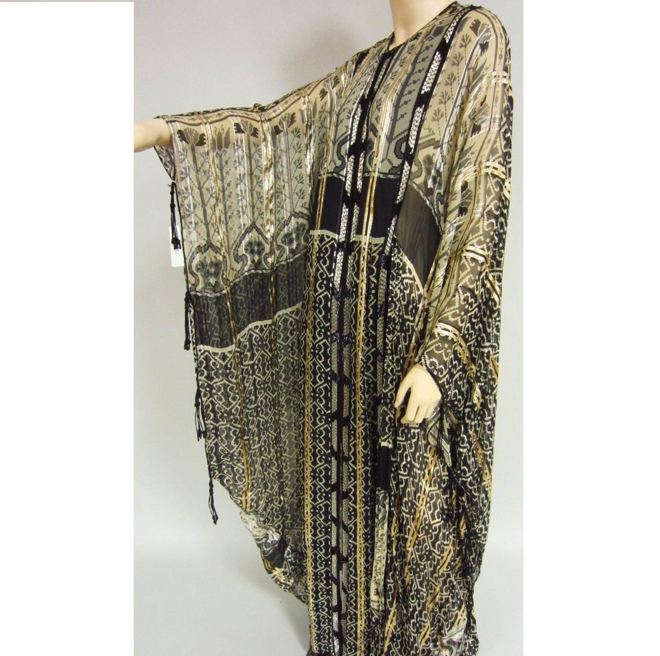 Vintage Black And White Beaded Kaftan By Thea Porter. Sold For $2,350.