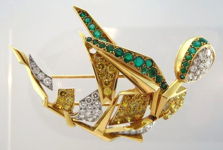 Cartier Gold & Platinum White & Yellow Round Diamond & Emerald Figural Brooch. Sold For $22,500